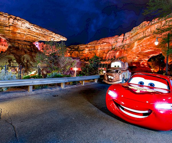 Cars Land Mater and Lightning McQueen racing at DISNEY CALIFORNIA ADVENTURE® Resort.